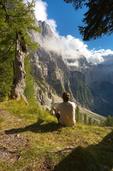 Resting man watching a mountain landscape, Triglav National Park, Slovenia