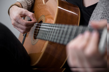 Close up of male hands playing acoustic guitar