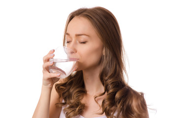 Beautiful young woman holding glass of water health