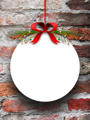 Blank Christmas circle round frame hanged by red ribbon against brick wall background