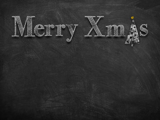 Chalk sketch drawing of Merry Christmas on blackboard with white Christmas tree