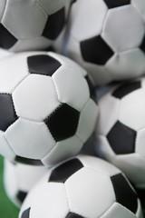 Stacked football soccer balls