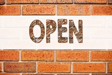 Conceptual announcement text caption inspiration showing Open. Business concept for shop Opening written on old brick background with copy space