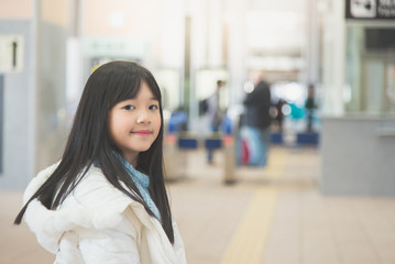 Beautiful Asian girl waiting for train