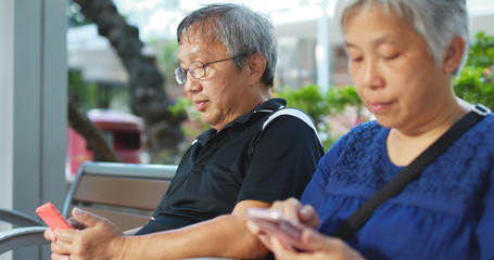 Old couple use of cellphone together