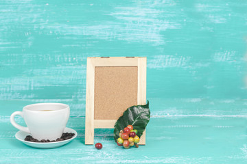 fresh coffee beans with cup of hot coffee and small board ,concept food and drink.