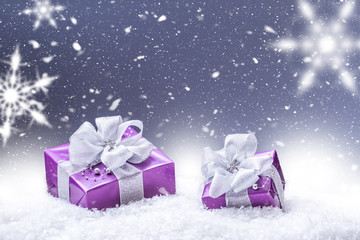 Purple christmas gift snow and abstract snowy background