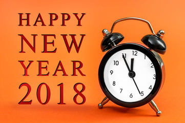 Greeting of Happy New Year 2018 with clock on  bright orange background. New year concept.