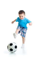 Full length portrait of kid boy playing with soccer ball isolated on white background