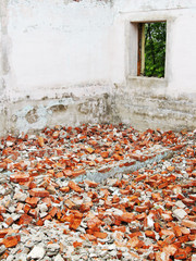 Destroyed house and fragments of bricks after the earthquake