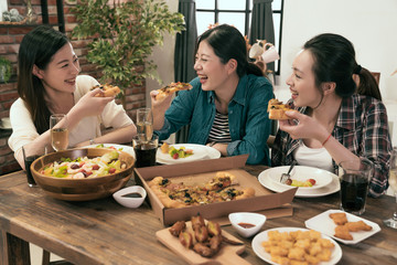 people enjoys pizza together at home