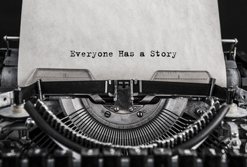 Everyone Has a Story typed words on a old vintage typewriter. Close up