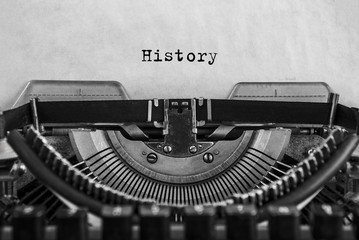 History typed on an vintage typewriter, old paper. close-up Wall mural