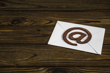 An e-mail symbol on a mail envelope. on the texture of the tree. place for design