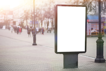 Vertical Isolated blank billboard on the city street. Mock up. for your advertising design Fotomurales
