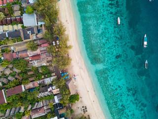 An aerial view of Gili Trawangan Island coastline with boats and buildings, West Nusa Tenggara, Indonesia