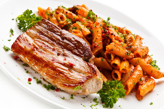 Pasta with tomato sauce and steak