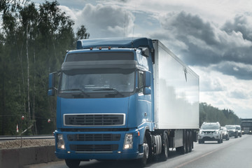 Blue Truck on the road under the dark sky