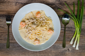 Flat lay of Spaghetti White sauce with shrimp, minced pork and spring onion