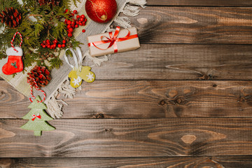 Christmas holiday flat lay view background. Xmas vintage above wooden table with gift box. Film toned filter