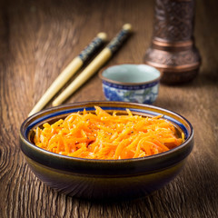 Korean carrots in a bowl, traditional appetizer, Asian style, tatsy food