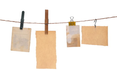 Blank instant photo hanging on clothesline. Isolated on white with clipping path
