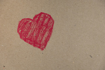 red heart drawn on a cardboard background