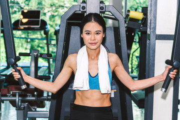 Fitness woman execute exercise with exercise-machine at the gym