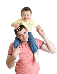 The little boy sits on shoulders at the father isolated on white