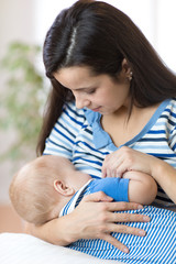 young mother breast feeding newborn baby