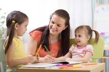 Teacher mom working with creative kids