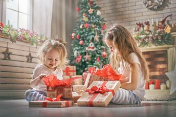girls opening gifts