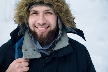 Bearded hipster man in winter clothers outdoor