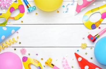 Children Party Background Colorful Frame With Cap And Whistle On Wooden