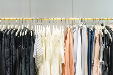 female clothes hanging on clothes rack