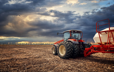 A powerful tractor works in the field