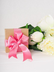 Small gift box decorated with ribbon and flower, Beautiful romantic gift box on wood