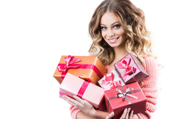 Happy attractive woman holding big pile of gifts.