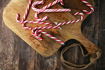 Christmas candy on brown wood. candy canes for xmas.