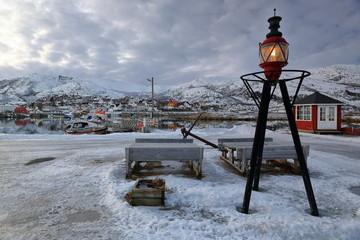 Harbor lantern upon metal tripod-picnic tables. Lodingen fishin port-Hinnoya-Lofoten-Norway. 0660