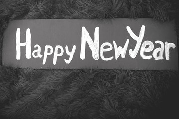 new year's sign on a wooden retro signboard