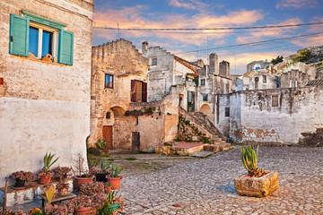 Matera, Basilicata, Italy: view at dawn of a small square in the old town Sassi di Matera Wall mural