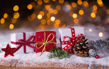 Christmas gifts in snow landscape