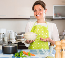 Woman cooking rice in the kitchen