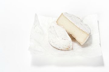 Cheese camembert on white paper. Menu design restaurant. Horizontal view. Cheese isolated.