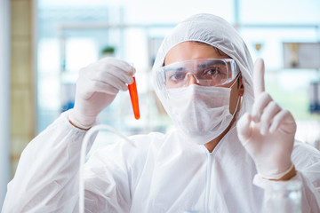 Chemist working in the laboratory with hazardous chemicals