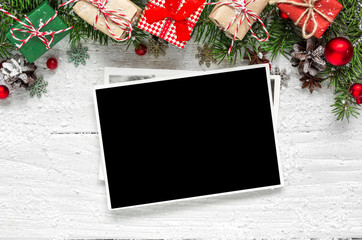 christmas blank photo frame with fir tree branches, decorations and gift boxes