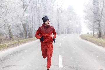Young man running on a cold winter day.