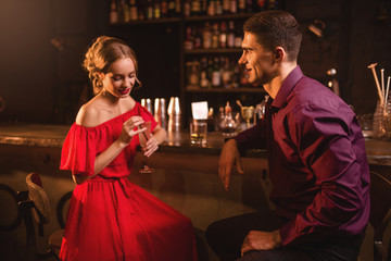 Woman in dress flirts with man in nightclub