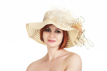 Emotional portrait of a naked girl and hat on white background.